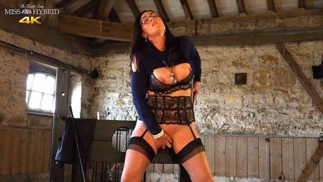 Dungeon mistress Miss Hybrid huge bust and pierced pussy lips.