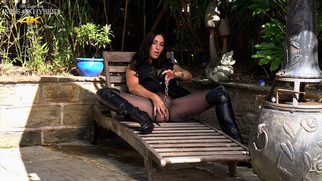 Thigh boots outdoors Miss Hybrid chaining her wet pussy.